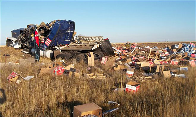 Semi truck hauling apples crashes on Hwy 97