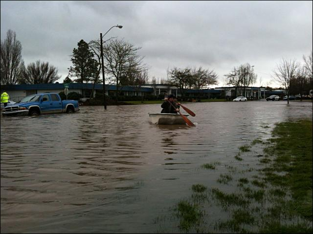 Boat floats down Corvallis Street