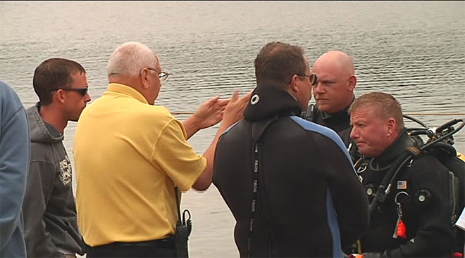 Divers recover boy's body from lake