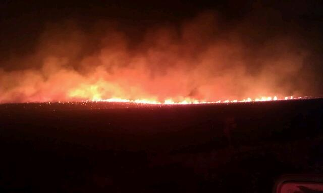 Brennan Pilon photo of Miller Homestead fire flames around midnight July 10