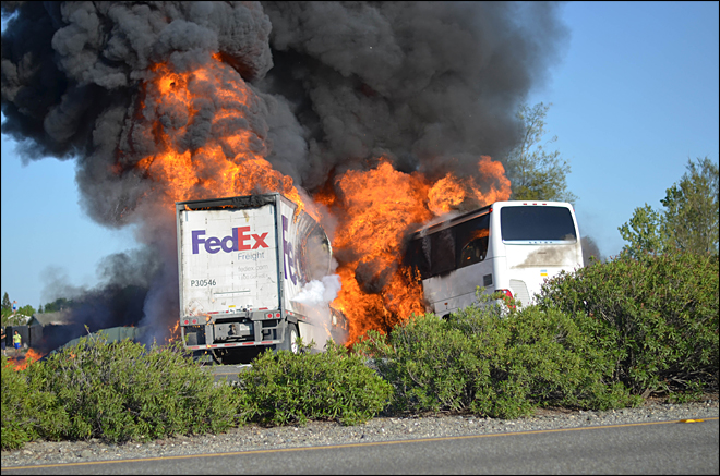 NTSB examines claim truck was on fire before bus crash