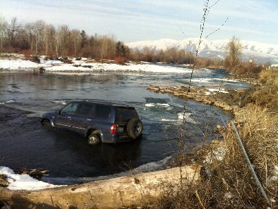 Photos: Car swerves to miss object, crashes into icy river