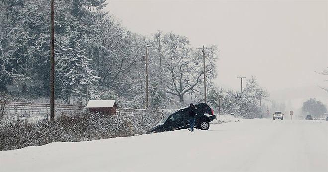 Car in ditch on West 11th Friday Dec 6