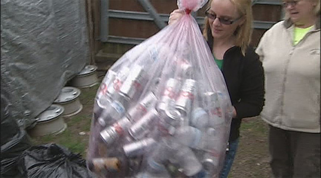 Collecting cans to cover college costs - 04