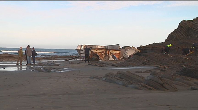 Crab boat washes ashore 11