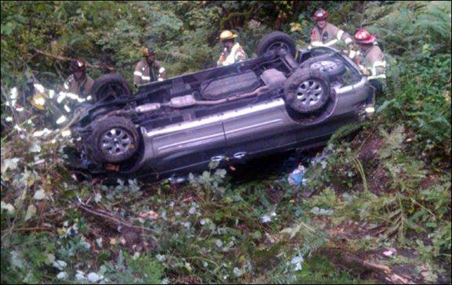 Man rescued after car crashes down steep ravine
