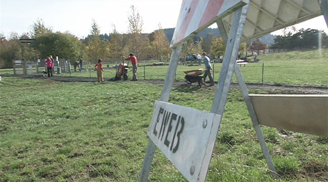 Volunteers spend Saturday fixing up the Amazon dog park