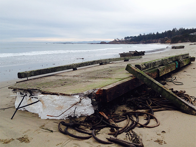 Pieces of dock wash ashore in Coos Bay