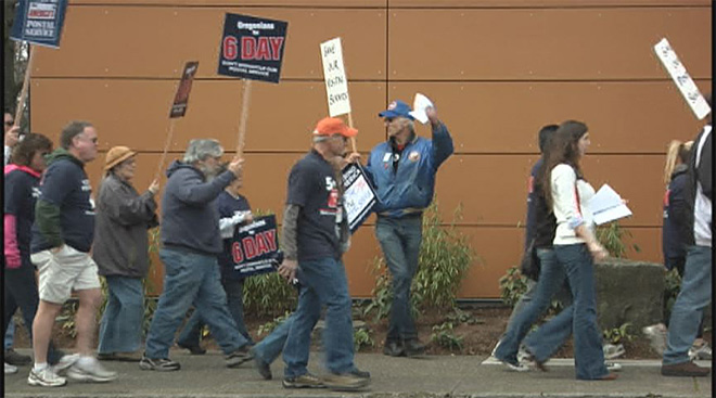 Dozens protest postal service changes at downtown office
