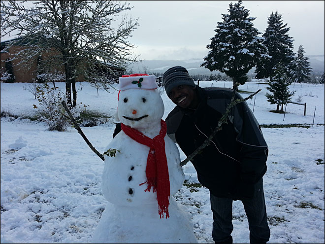 Elisabeth Feland photo from Camas Valley of visitor from Haiti experiencing snow for first time