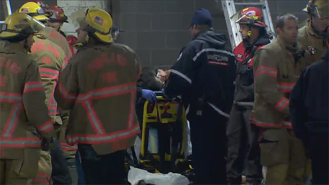 Firefighters rescue woman trapped between buildings (1)