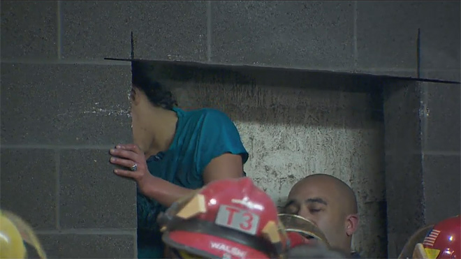 Firefighters rescue woman trapped between buildings (12)