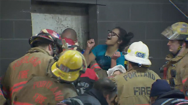 Firefighters rescue woman trapped between two buildings