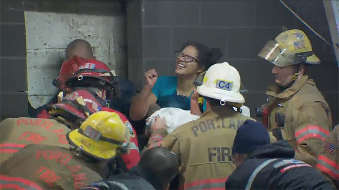 Firefighters rescue woman trapped between buildings (15)