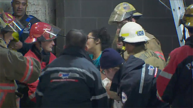 Firefighters rescue woman trapped between buildings (16)