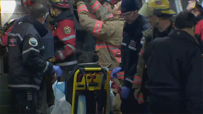 Firefighters rescue woman trapped between buildings (3)
