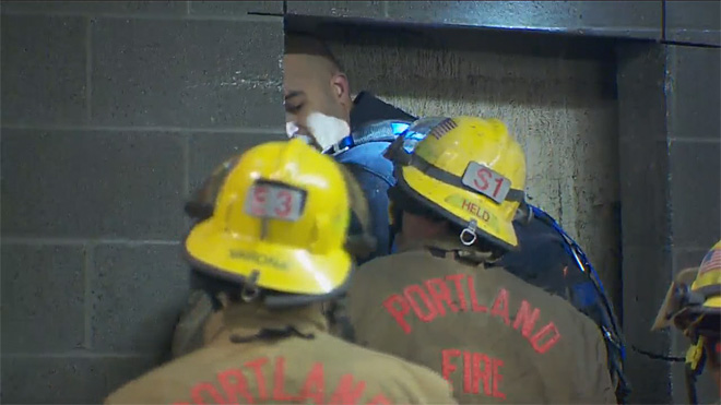 Firefighters rescue woman trapped between buildings (4)