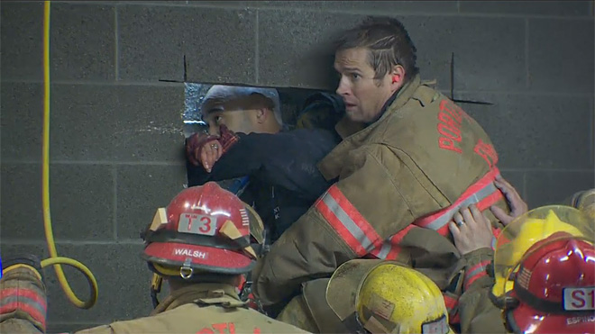Firefighters rescue woman trapped between buildings (6)