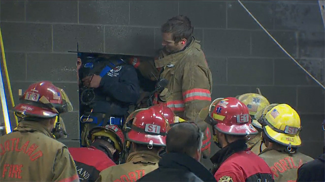 Firefighters rescue woman trapped between buildings (8)