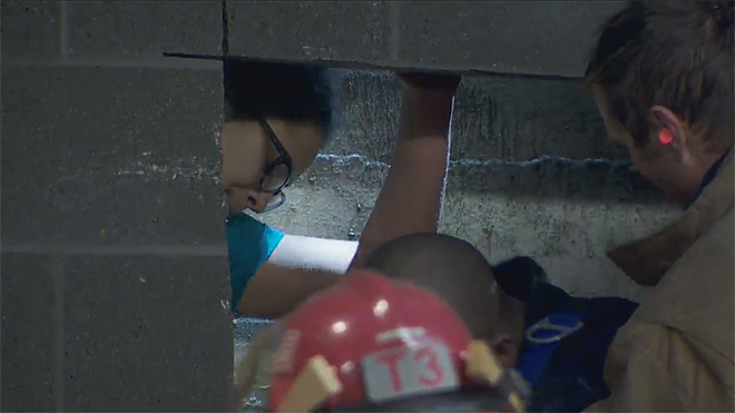 Firefighters rescue woman trapped between buildings (9)