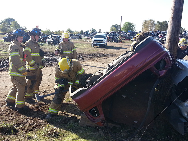 Firefightrs practice extricating victims from cars (2)