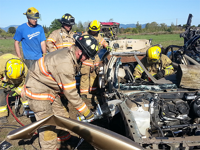 Firefighters practice ripping wrecked cars apart
