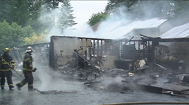 Garage fire destroys two cars, causes $75,000 in damage