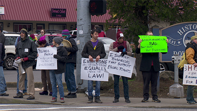 Dozens of protesters gather outside Sweet Cakes bakery