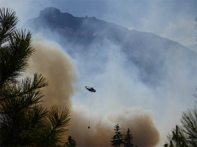 Helicopter drops water on the fire with the North Sister in the background - Credit_Dan Komning.jpeg