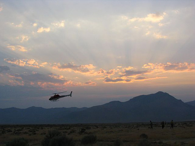 Helicopter returns to Denio on Nevada part of Holloway Fire by John Fiddler.jpeg