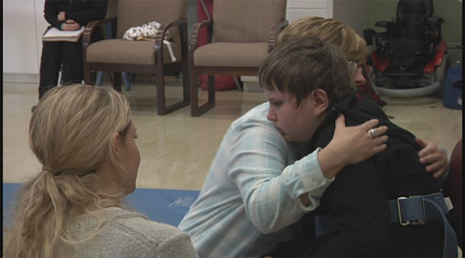 Boy who had half his brain removed on long road to recovery