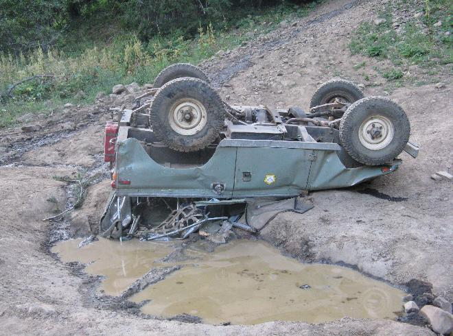 Vintage Land Rover overturns, traps driver during off-road outing