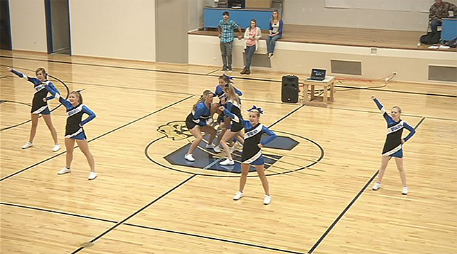 Keely cheering at Glide High (1)