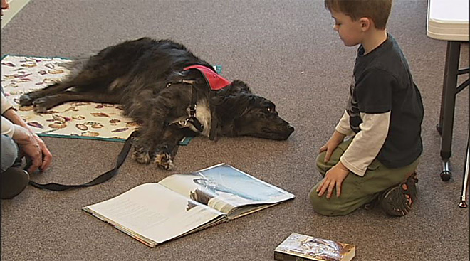Kids read to dogs at the Fern Ridge Library