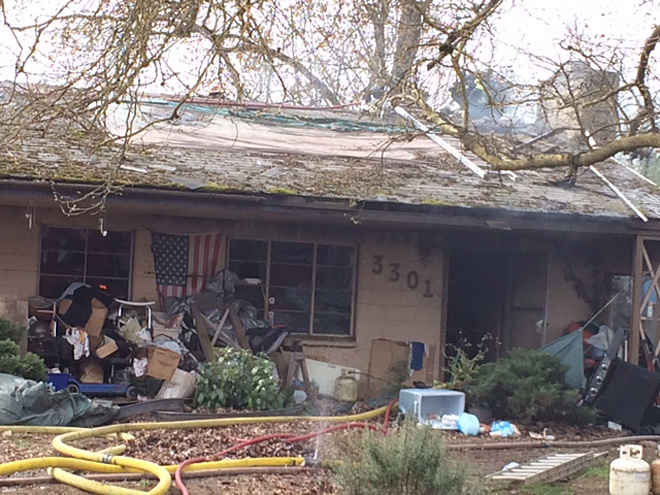 Neighbors report Eugene house fire