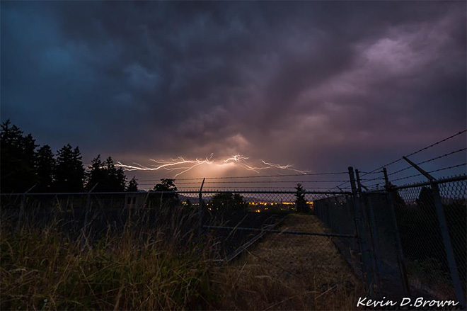 Lightning bolts streak across Oregon's night skies - Photo by Kevin Brown - sunset at Skinner Butte