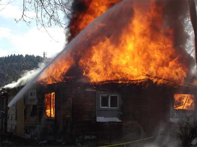 Fire crews practice by burning down house