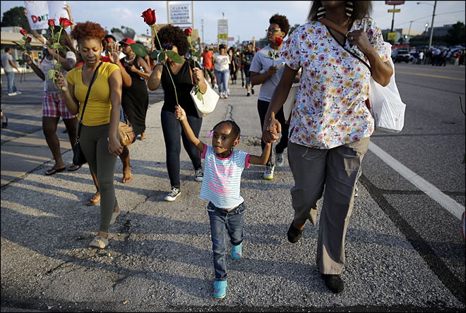 Streets of Ferguson stay calm after violent nights