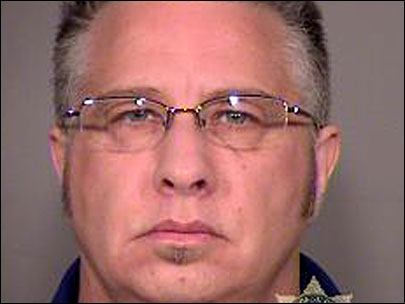 Former police sergeant arrested in wife's murder case
