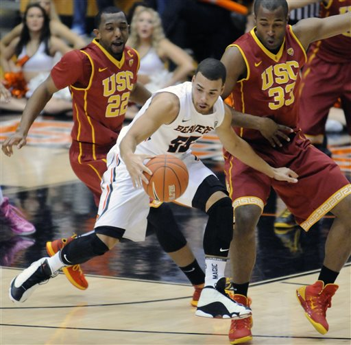 Beavs outlast Trojans in OT