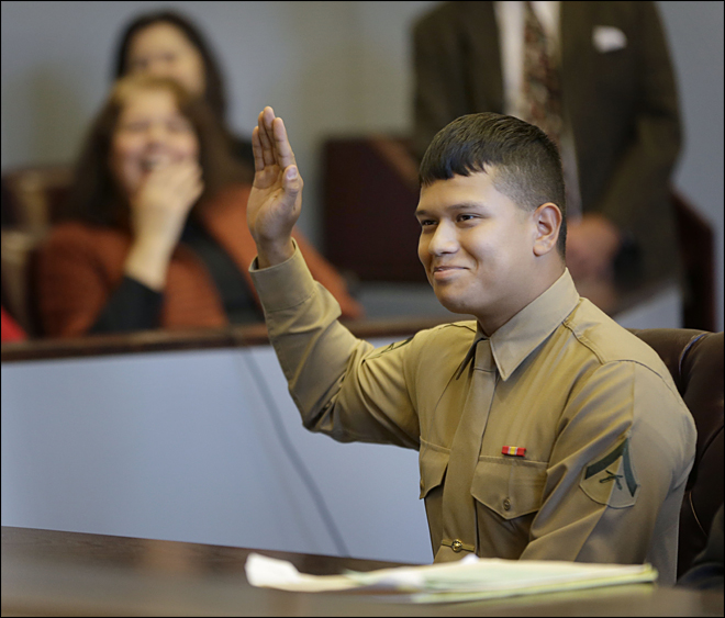 Marine gets adopted in Christmas Eve ceremony