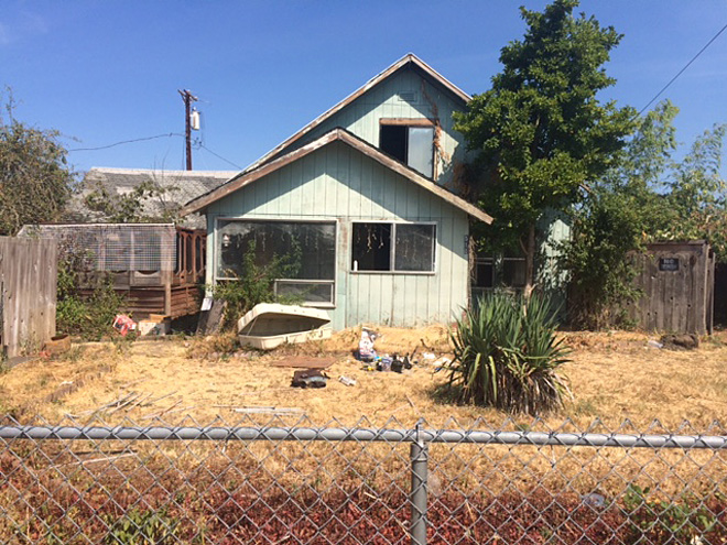 Mess on M Street: City wants property owner to clean up