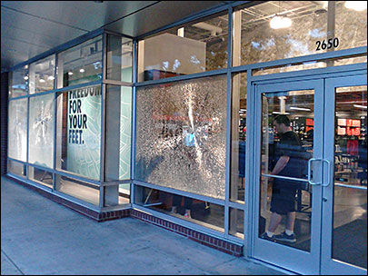 Vandal breaks Nike store windows with baseball bat