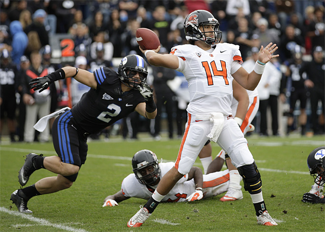 Vaz throws 3 TDs, No. 10 Beavers beat BYU 42-24