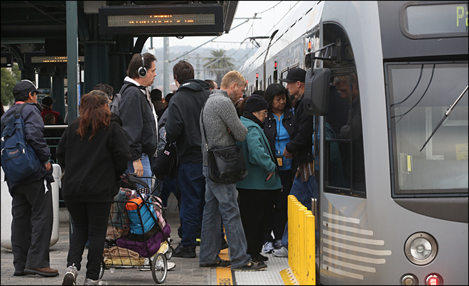 Americans riding public transit in record numbers