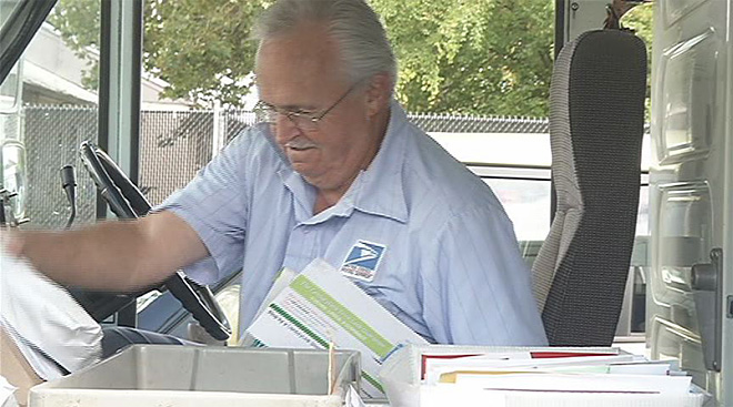 Letter carrier Ron Fisher retires