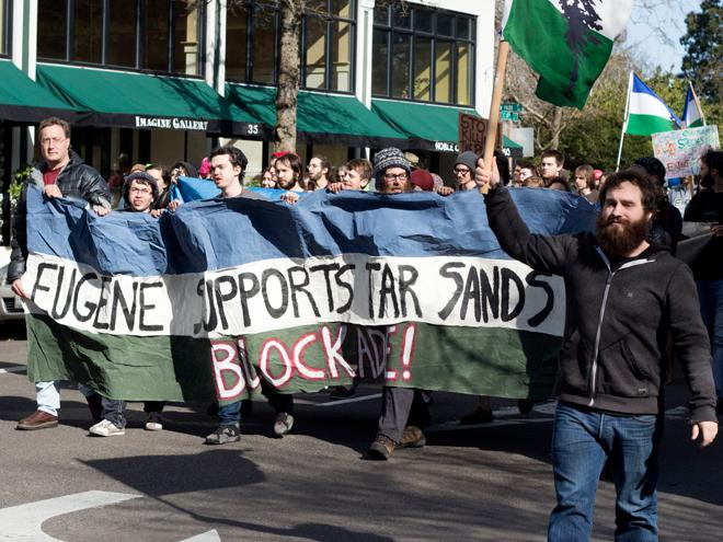 Protesters target banks financing tar sands, pipeline