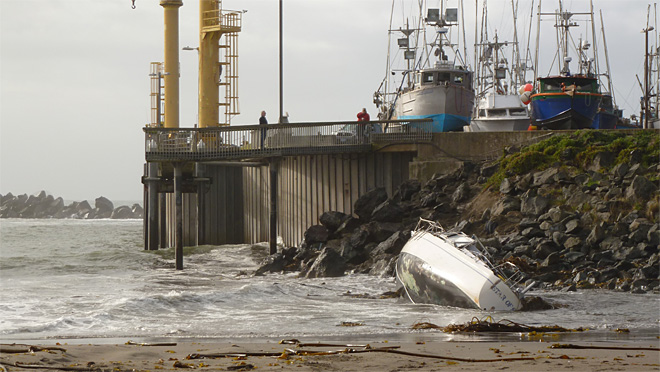 Storm-battered sailboat washes up on rocks in Oregon port