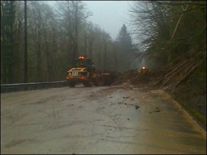Landslide dumps mud, rocks and trees on Hwy. 20