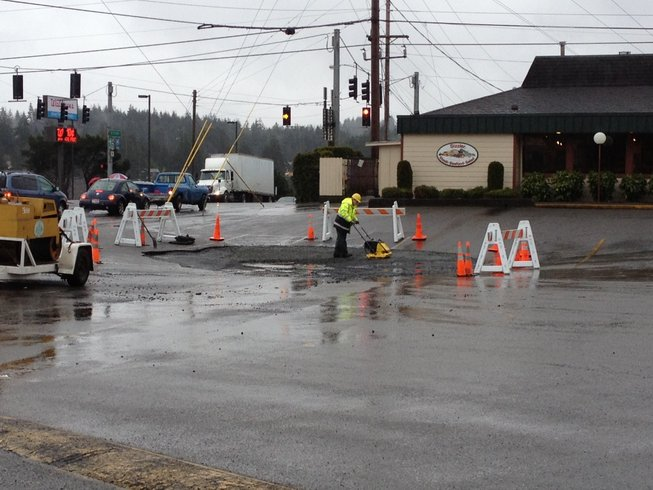 Sinkhole opens up in Sizzler parking lot